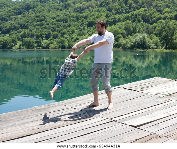 Father and child on the lake