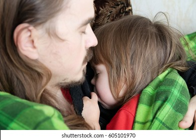 Father and child sleeping together on armchair. Family resting. Happy parenthood, fatherhood. Dad and daughter wrapped in blanket sleep quite.