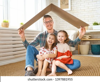 Father and children girls in the room with a symbol of roof. Concept of protection for kids.