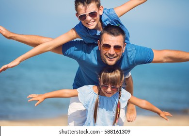 Father with children having fun.  Summer, family, vacation concept