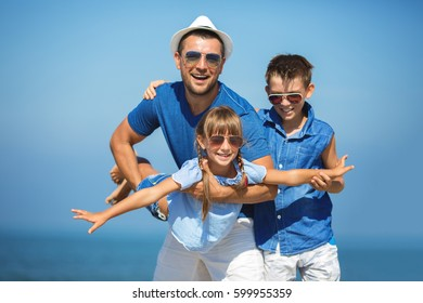 Father with children having fun.  Summer, family, vacation concept.