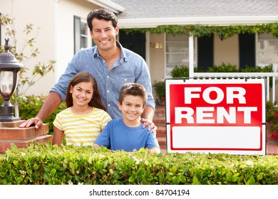 Father and children outside home for rent