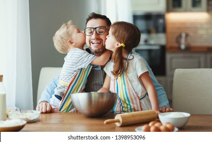 father with children preparing food, baking cookies