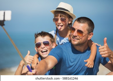 Father with children taking selfie.  Summer, family, vacation concept