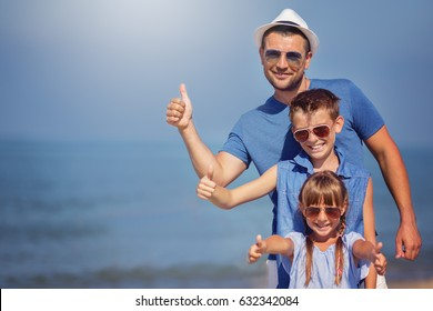 Father with children taking selfie.  Summer, family, vacation concept.