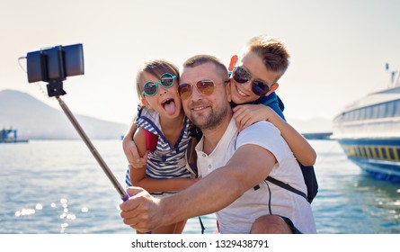 Father with children are waiting summer sea vacation.