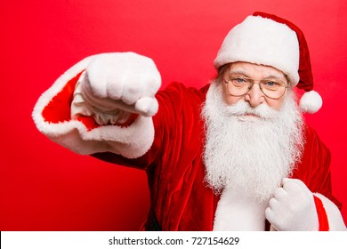 Father christmas beats fists, knuckle. Newyear fight, fit, boxer, boxing, athlete, strength, attack, authority, danger, muscular, sport, training, masculinity, gifts, presents, noel x mas concept