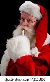 father Christmas gesturing shush