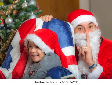 Father Christmas and an happy kid