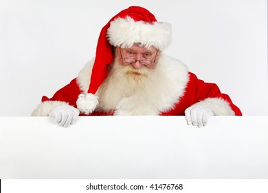 father christmas holding a blank sign with room for text