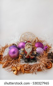 Father Christmas (Santa Claus) with a snowman in the tinsel. among Christmas balls and Christmas decoration.