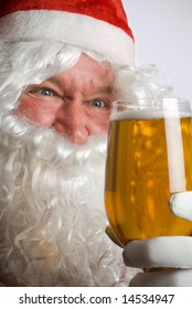 Father Christmas Santa looks at a lovely glass of beer
