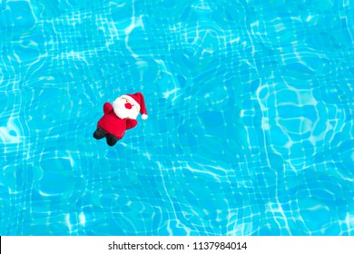 Father christmas tree ornament floating on a swimmingpool