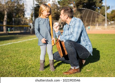 Father coach teach daughter baseball