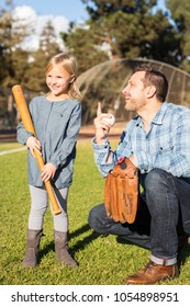Father coach teach daughter baseball