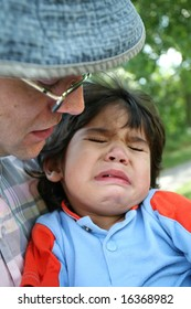 Father consoling crying toddler