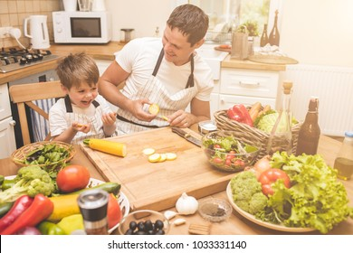 Father is cooking with his son