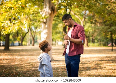Father criticizing his disobedient child for bad behavior. Children upbringing.