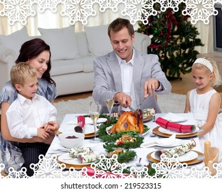 Father cutting a turkey in Christmas dinner against snowflake frame
