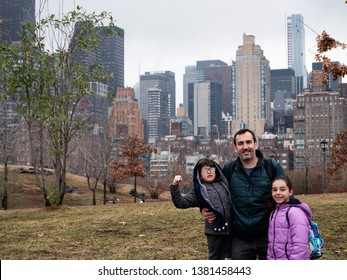 Father, daugher and son at Roosevelt Island, New York City, cold winter day.