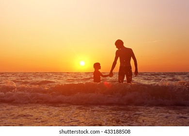 father and daughter admire the sunset on the sea. vacation at the seaside