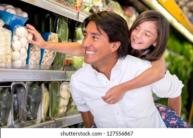 Father and daughter buying groceries at the supermarket