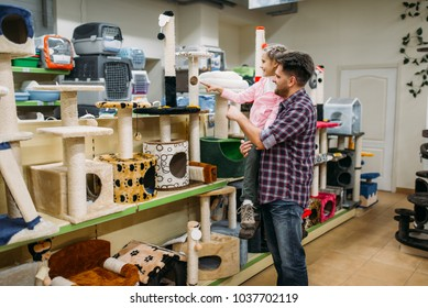 Father and daughter buying supplies in petshop