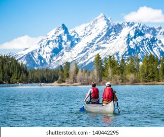 Father and daughter canoeing on Jackson Lake in the Grand Teton National Park.