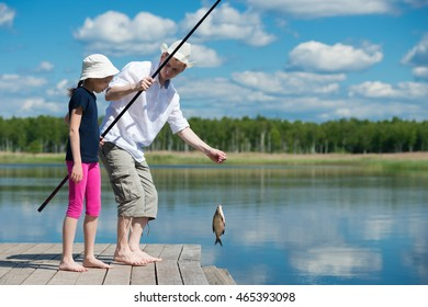 Father daughter caught a fish in the river