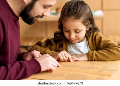father and daughter choosing food in menu