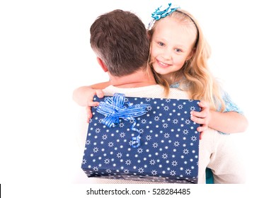 father and daughter with a Christmas present