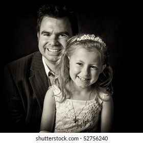 father and daughter close up in black and white. happy smiling faces. proud dad and his girl. holy communion dress in ireland. irish family portrait. beautiful family happy face.