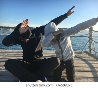 Father and daughter doing dab on the pier
