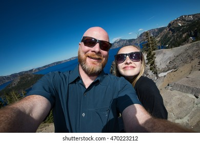 Father and Daughter family selfie at Crater Lake, Oregon