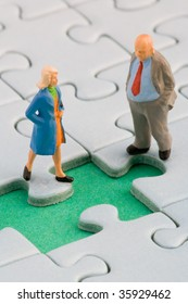 Father and daughter in front of a missing jigsaw piece