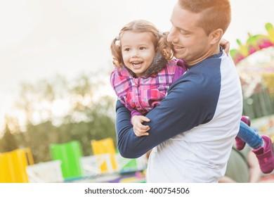Father and daughter having fun, fun fair, amusement park