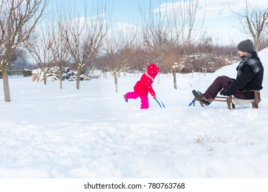 Father and daughter having fun on winter day