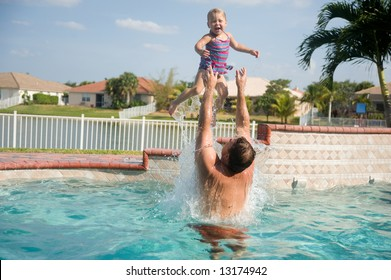Father and Daughter Having Fun in Pool