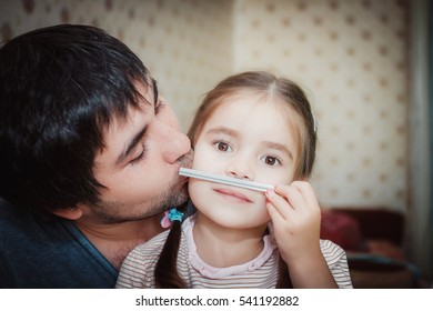 Father and daughter having fun together at home