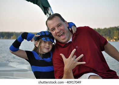 father and daughter having a hip hop moment on the boat