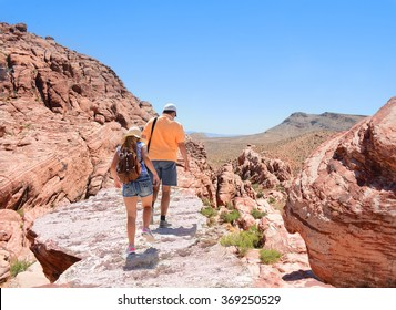 Father and daughter hiking in Red Rock Canyon, Nevada, USA.