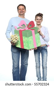 Father and daughter holding a present for mom - smiling