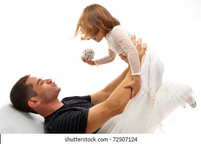 Father and daughter laying on floor on white background .