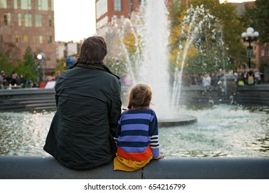 Father and Daughter looking at fountain