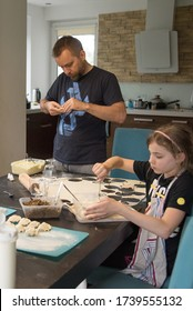 Father and daughter making a dough