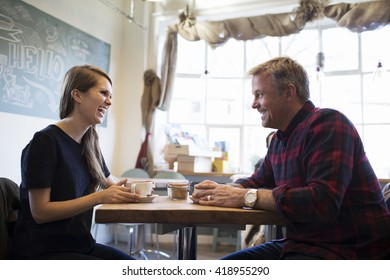 Father And Daughter Meeting In Coffee Shop