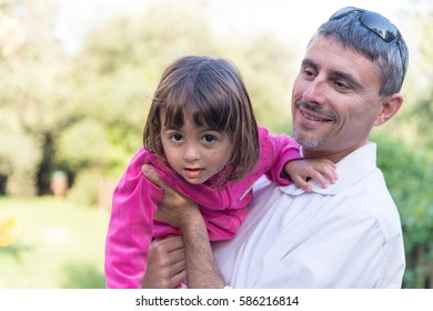 Father and daughter on a city park.