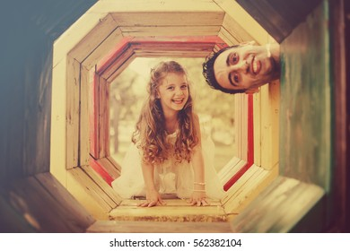 Father and daughter playing on playground