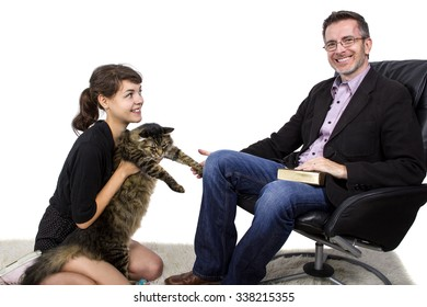 Father and Daughter playing with a pet cat on a shag carpet.  The family is isolated on a white background.