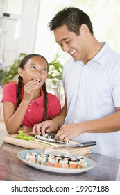 Father And Daughter Preparing Sushi Together